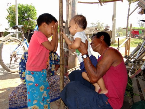 European baby playing with the locals of Myanmar