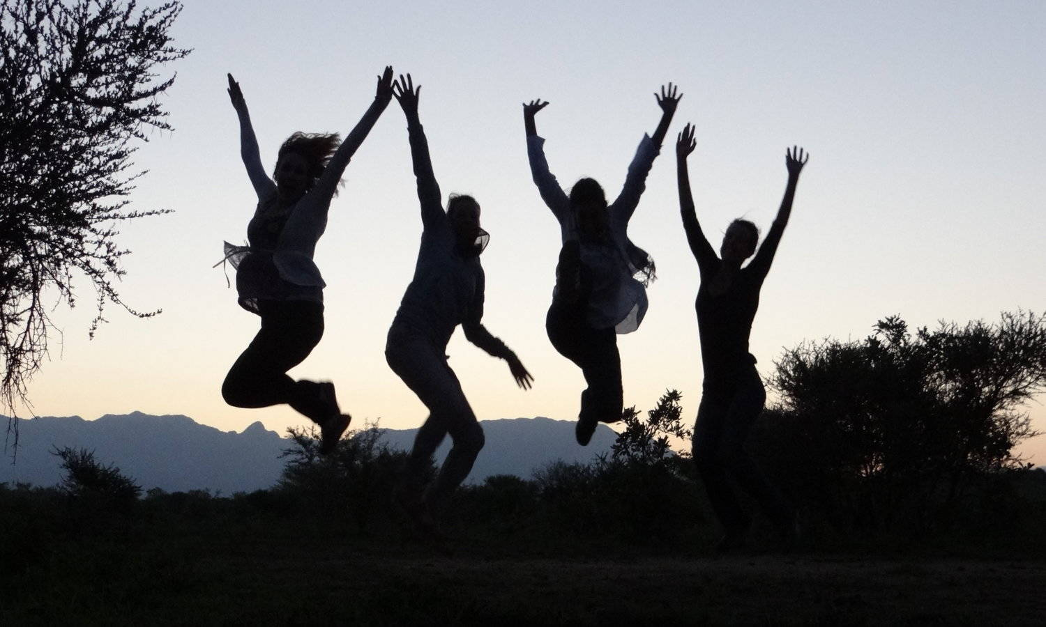 Silhoutes jumping high, communicate with joy